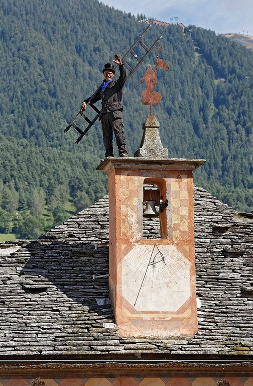 [ITALY.PIEMONTE 11090] 'Chimney sweep on the roof of the town hall in Santa Maria Maggiore.'  Swedish chimney sweep on the roof of the town hall in Santa Maria Maggiore during the International Chimney Sweeps Gathering (Raduno Internazionale dello Spazzacamino) in Valle Vigezzo. Photo Paul Smit.