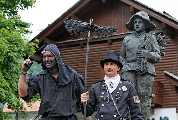 [ITALY.PIEMONTE 11031] 'German and Romanian chimney sweep in Malesco.'  A german (left) and a romanian chimney sweep pose for a photo around the Monument of the Little Chimney Sweep in Malesco during the International Chimney Sweeps Gathering (Raduno Internazionale dello Spazzacamino) in Valle Vigezzo. Photo Paul Smit.