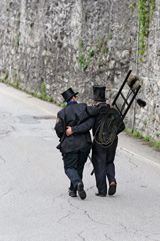 [ITALY.PIEMONTE 11030] 'Meeting up with an old friend.'  Meeting up with an old friend and colleague during the International Chimney Sweeps Gathering (Raduno Internazionale dello Spazzacamino) in Valle Vigezzo. Photo Paul Smit.