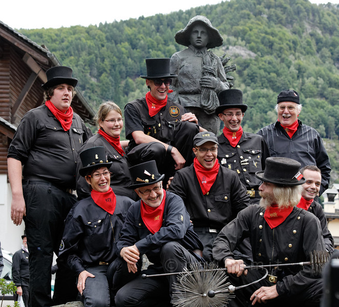 ITALY.PIEMONTE 11032] 'Swiss chimney sweeps in Malesco.'  Swiss chimney sweeps, gathered around the Monument of the Little Chimney Sweep in Malesco, Valle Vigezzo, pose for a group photo during the International Chimney Sweeps Gathering (Raduno Internazionale dello Spazzacamino). Photo Paul Smit.