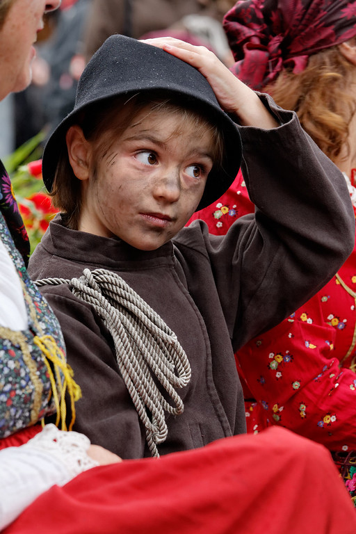 [ITALY.PIEMONTE 11041] 'Little chimney sweep in Malesco.'  During the International Chimney Sweeps Gathering (Raduno Internazionale dello Spazzacamino) in Valle Vigezzo you not only see real chimney sweeps but also people from the valley putting on traditional dress to celebrate the old days. Nowadays, as folklore, that past looks as if it was happy. But in reality Valle Vigezzo was extremely poor and many children (boys, not girls) had to leave home in winter to live the hard and hungry life of little chimney sweeps in the cities of the Po plain. Photo Paul Smit.