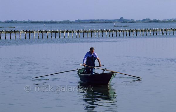 Fisherman in Lagoon of Venice.