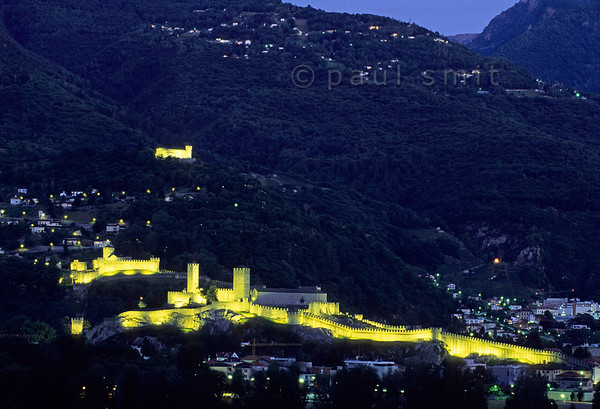 [SWITZER.TICINO 01302]  'World heritage site.'   The three strongholds of Bellinzona gard the Ticino valley. Since the Gotthardpass route followed that valley towards Italy, who owned these castles controlled a principal traderoute across the Alps. UNESCO added the complex to their list of World Heritage Sites. Photo Paul Smit.