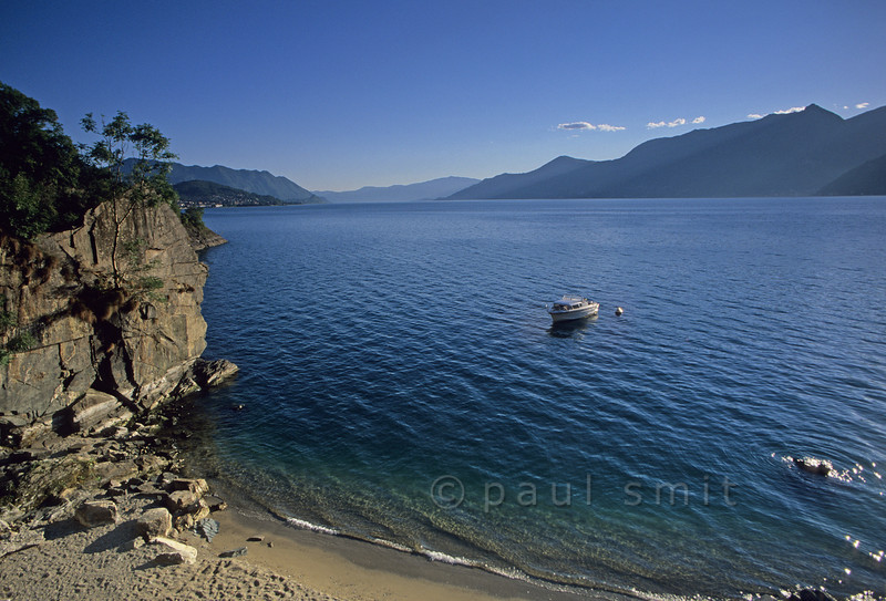 [ITALY.LOMBARDIA 01747]  'Beach near Luino.'  The eastern shore, part of Lombardia, is many times more quiet then the Piedmonte shore in the west with its many attractions. So head east if you want to find a small beach for yourself. Photo Paul Smit.