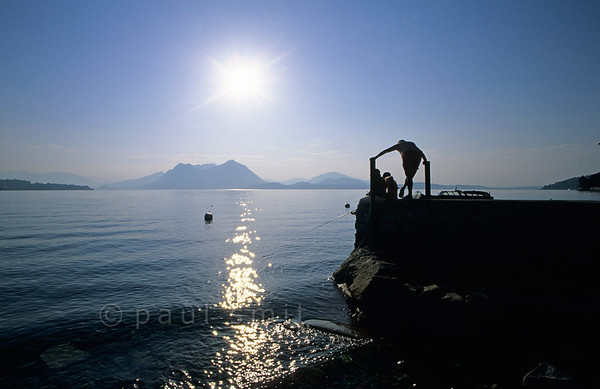 [ITALY.PIEMONTE 01650]  'Angler at Isola dei Pescatori.'  Trying to catch an early morning fish at Isola dei Pescatori, the Fishermen's Island in Lago Maggiore. Photo Paul Smit.