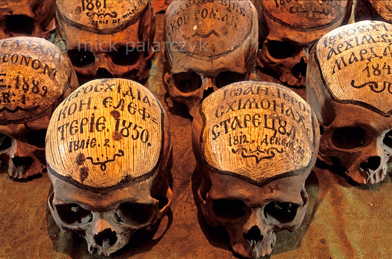 [ROMANIA.MOLDAVIA 24.130] 'Dated skulls.'  The skulls in the ossuary of the 15th century Neamt Monastery bear little texts stating the names and dates of the monks. Photo Mick Palarczyk.