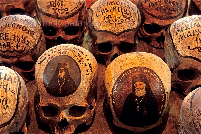 [ROMANIA.MOLDAVIA 24.125] 'Lively skulls.'  Some of the skulls in the ossuary of the 15th century Neamt Monastery are painted with a small portrait of the person the skull belonged to during life. Others simply state the names of the monks and their dates of birth and death. Photo Mick Palarczyk.