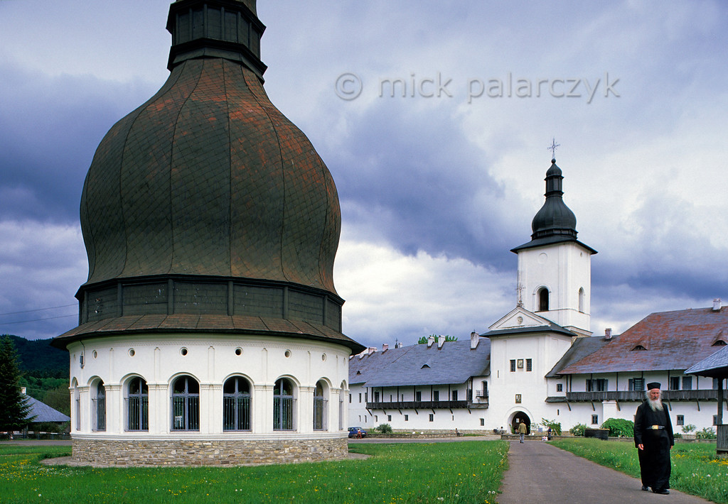 """[ROMANIA.MOLDAVIA 24.123] 'Neamt Monastery.'  Outside the 15th century Neamt Monastery stands, topped by a huge dome, the Aghiastmatar Pavilion, built for the ritual of """"blessing the Water"""". Photo Mick Palarczyk."""