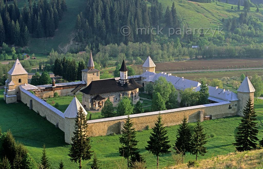 [ROMANIA.MOLDAVIA 24.042] 'Sucevita Monastery.'  The Sucevita Monastery in northern Moldavia was founded in 1582. Its massive walls were meant to ward off infidel invaders. Photo Mick Palarczyk.