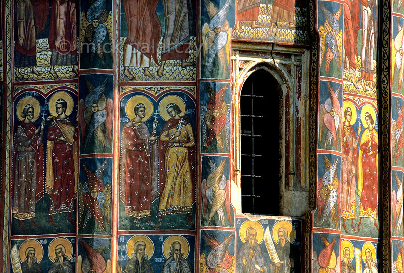 [ROMANIA.MOLDAVIA 23.956] 'Saintly parade.'  A parade of saints covers the choir of Moldovita's monastery church. The frescoes were done in 1537 by Toma of Suceava. Photo Mick Palarczyk.