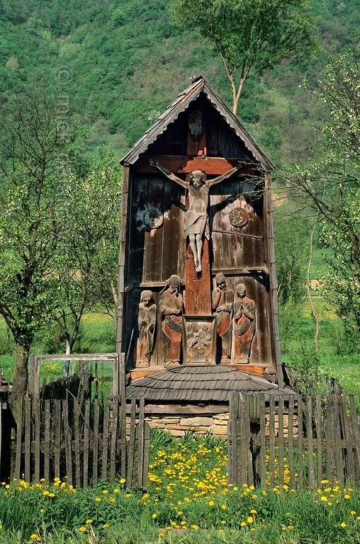 [ROMANIA.MARAMURES 23.704] 'Crucifix.'  The crucifix (troita) at Berbesti is a masterpiece of 17th century woodcarving. Photo Mick Palarczyk.