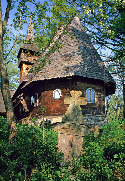 [ROMANIA.MARAMURES 23.686] 'Wooden splendour.'  	The Maramures is famous for its wooden churches. This one, at Harnicesti, dates from 1728. Photo Mick Palarczyk.