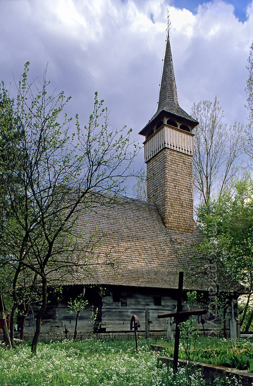 [ROMANIA.MARAMURES 23.691] 'Wooden church of Sacalaseni.'  The Maramures is famous for its wooden churches. This one, at Sacalaseni (south of Baia Mare), originally dates from 1442 but was rebuilt in the 17th century. Photo Mick Palarczyk.