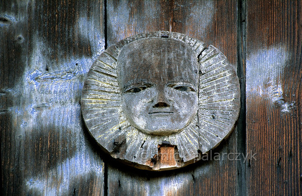 [ROMANIA.MARAMURES 23.727] 'Heathen sun.'  On the 17th century Berbesti crucifix images of the sun and moon represent the male and female principles. They are echoes of prechristian elements still present in Maramures society. Photo Mick Palarczyk.