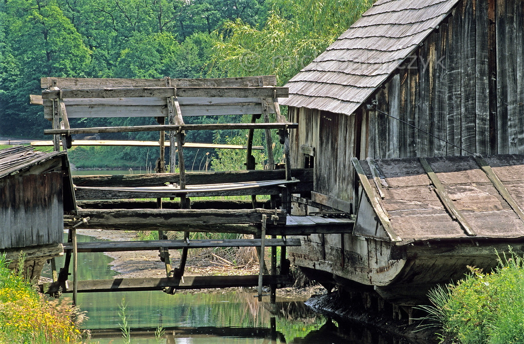 [ROMANIA.TRANSYLVA 23.788] 'Marooned ship mill.'  This originally floating watermill from the river Olt, here seen in the Sibiu open air museum in a non floating position, is one of the last surviving ship mills of Europe. (See also picture 23781.) Photo Mick Palarczyk.