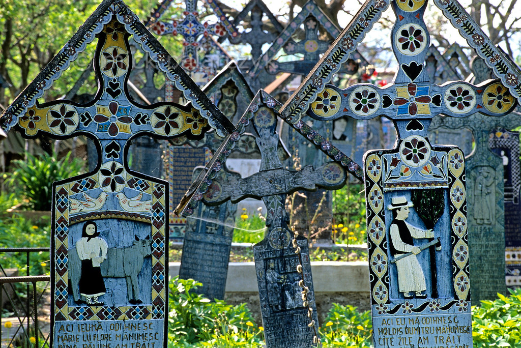 [ROMANIA.MARAMURES 23.733] 'The Merry Cemetery.'  At the Merry Cemetery (Cimitir vesel) of Sapînta local artist Stan Patras has decorated the crosses with scenes from the lives of the deceased. The blue colour is used as a symbol for hope and freedom. Photo Mick Palarczyk.