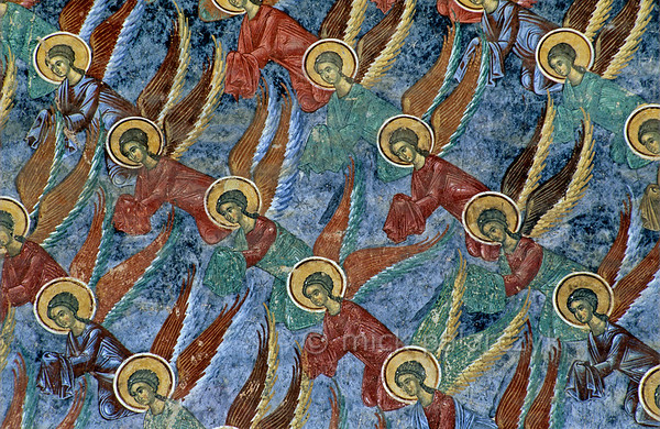 [ROMANIA.MOLDAVIA 24.109] 'Angelic order.'  	Angels on the heavenly blue north wall of Sucevita monastic church fly in mathematical order. The frescoes on the church were painted by the brothers Ioan and Sofronie of Suceava in 1595. Photo Mick Palarczyk.