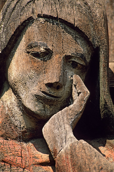 [ROMANIA.MARAMURES 23.717] 'Mourning figure.'  	Mourning figure at the foot of the 17th century crucifix at Berbesti. Photo Mick Palarczyk.