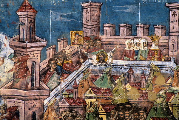 [ROMANIA.MOLDAVIA 23.928] 'The siege of Constantinople.'  	Moldovita Monastery was founded as a stronghold to resist the Ottoman advance after the fall of Constantinople in 1453. To raise morale this fresco shows an earlier failed siege of the city where the enemy is deterred with the help of miraculous icons being paraded around the ramparts. Photo Mick Palarczyk.