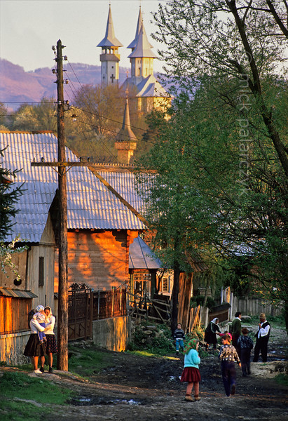 [ROMANIA.MARAMURES 23.644] 'Village street.'  	After a hard day's work in the field the villagers of Breb spend a peaceful evening in their main street. Photo Mick Palarczyk.