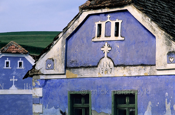 [ROMANIA.TRANSYLVA 24.179] 'Blues in Ighisu Vechi.'  	Many houses in southern Transylvania are painted in bright colours as here in the village of Ighisu Vechi. Photo Mick Palarczyk.