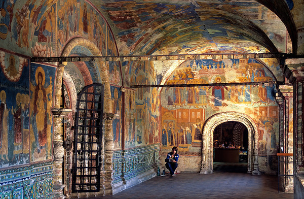 [RUSSIA.GOLDENRING 26.050] 'Working among frescoes.'  	An art student is making drawings of the 17th century frescoes in the west vestibule Yaroslavl's St. Elijah the Prophet Church. The church was built by rich fur dealers. The frescoes are by Gury Nikitin of Kostroma and his school. Photo Mick Palarczyk.