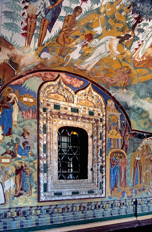 [RUSSIA.GOLDENRING 26.164] 'Glazed tiles and frescoes.'  	The windows and plinth of the southern vestibule in Tutayev's 17th century Resurrection Cathedral are decorated with the glazed tiles for which the Yaroslavl region is renowned. The vaulted ceiling has scenes from Genesis with Adam receiving the breath of life and talking to the animals in Paradise. Photo Mick Palarczyk.