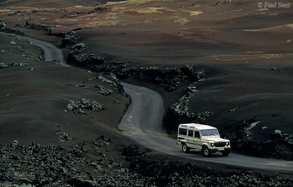 [SPAIN.CAN.LANZAROTE 9342] 'Route of the Volcanoes 3.'  Landrover on the Route of the Volcanoes in a landscape of devilish beauty. Timanfaya national park. Photo Paul Smit.