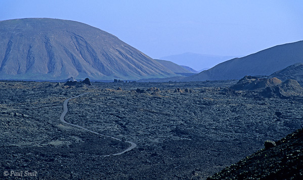 [SPAIN.CAN.LANZAROTE 9302] 'Driving on lava.'  Early morning atmosphere on the Timanfaya national park road crossing a huge lava field. The volcanoes in the park area erupted for the last time in the 19th century and vegetation has not yet returned. Photo Paul Smit.