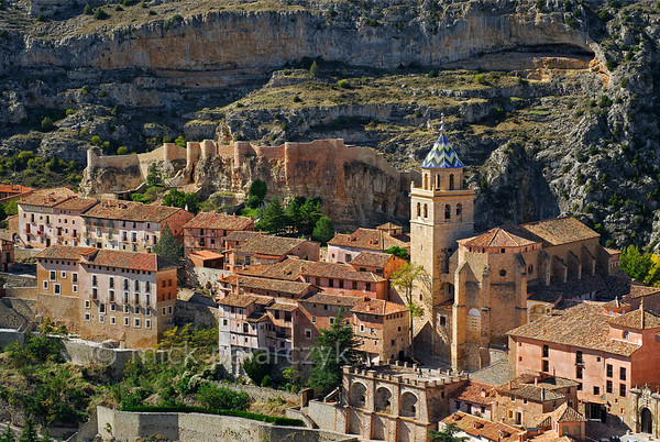 [SPAIN.ARAGON 28686] 'Albarracín and its castle.'  	Albarracín is a beautifully preserved medieval town in the canyon of the Guadalaviar river in the southwest of Teruel province. Its castle is a Moorish fort (alcazaba) of the 10th century, built during the caliphate of Córdoba. In the 11th century the town became the capital of a taifa, an independent Muslim state ruled by the Banu Razin dynasty, whose family name would lend the town its name (Sahla Banu Razin). From 1170 till 1285 it was the capital of the small independent Christian kingdom of the Azagra family. Its medieval cathedral was remodeled in the 16th and 18th centuries. Photo. Mick Palarczyk.