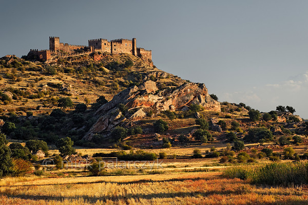 [SPAIN.CMANCHA 28566] 'Castle of Riba de Santiuste.'  Surrounded by a beautiful stretch of wild countryside the castle of Riba de Santiuste sits atop a hill in the eastern part of Guadalajara province. The original Moorish castle was taken by the Christians in the 11th century and rebuilt in the 15th. Photo Mick Palarczyk.