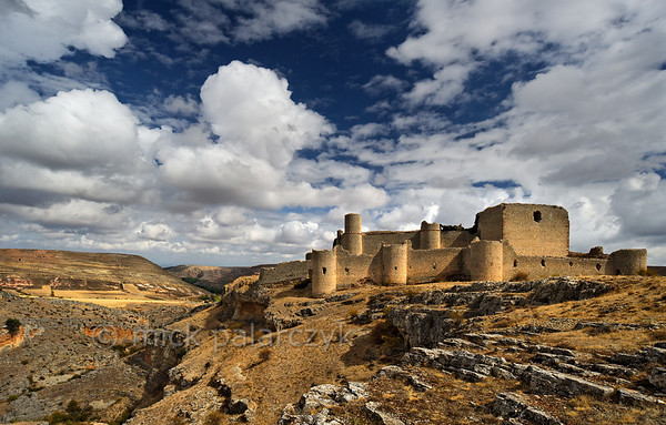 [SPAIN.CLEON 28654] 'Caracena Castle seen from the south.'  	In the remote mountains of southern Soria province the ruined castle of Caracena balances on the edge of a gorge that empties into the Rio Caracena. The castle originally dates from the 12th century but was completely rebuilt in 15th. Photo Mick Palarczyk.