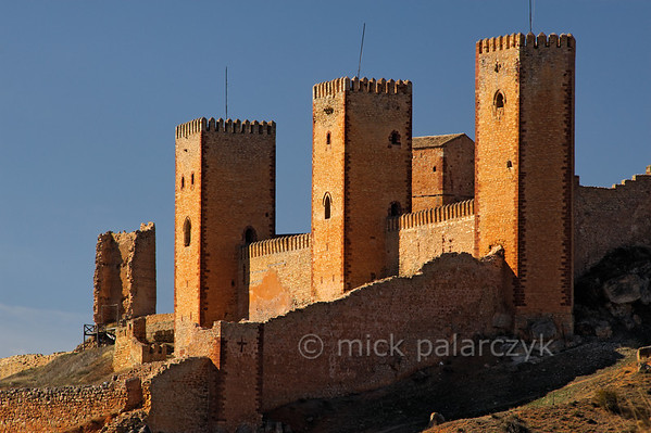 [SPAIN.CMANCHA 28535] 'Molina de Aragon.'  	The castle of Molina de Aragon (Guadalajara province) was founded by the Moors in the 10th century. Molina was conquered by the king of Aragon in 1129 and was rebuilt in the 12th and 13th century. The actual castle, with the high towers we see in this picture, was built into a corner of the alcazaba precinct. Photo Mick Palarczyk.