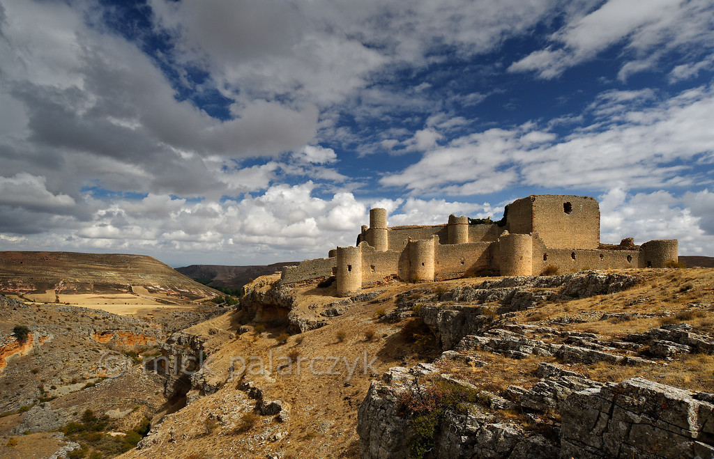 [SPAIN.CLEON 28655] 'Caracena Castle seen from the south.'  In the remote mountains of southern Soria province the ruined castle of Caracena balances on the edge of a gorge that empties into the Rio Caracena. The castle originally dates from the 12th century but was completely rebuilt in 15th. Photo Mick Palarczyk.