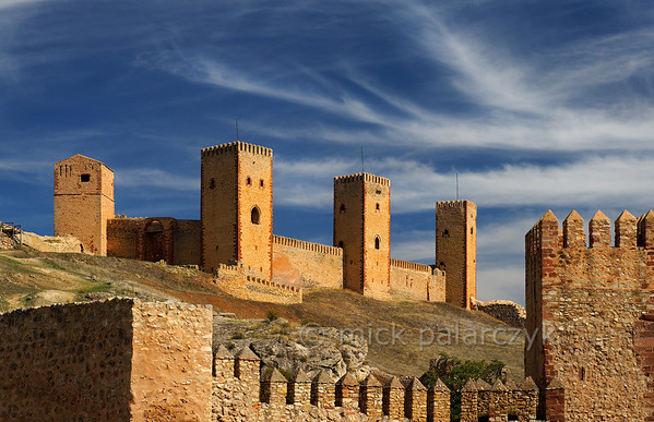 [SPAIN.CMANCHA 28537] 'Castle towers of Molina de Aragon.'  	The castle of Molina de Aragon (Guadalajara province) was founded by the Moors in the 10th century. Molina was conquered by the king of Aragon in 1129 and was rebuilt in the 12th and 13th century. The actual castle, with the high towers we see in this picture, was built into a corner of the alcazaba precinct. Photo Mick Palarczyk.