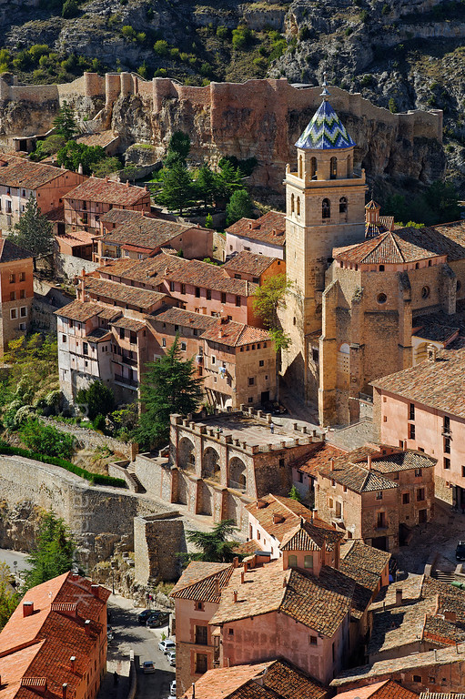 [SPAIN.ARAGON 28687] 'Albarracín and its castle.'  Albarracín is a beautifully preserved medieval town in the canyon of the Guadalaviar river in the southwest of Teruel province. Its castle (visible in the background) is a Moorish fort (alcazaba) of the 10th century, built during the caliphate of Córdoba. In the 11th century the town became the capital of a taifa, an independent Muslim state ruled by the Banu Razin dynasty, whose family name would lend the town its name (Sahla Banu Razin). From 1170 till 1285 it was the capital of the small independent Christian kingdom of the Azagra family. Its medieval cathedral was remodeled in the 16th and 18th centuries. Photo Mick Palarczyk.