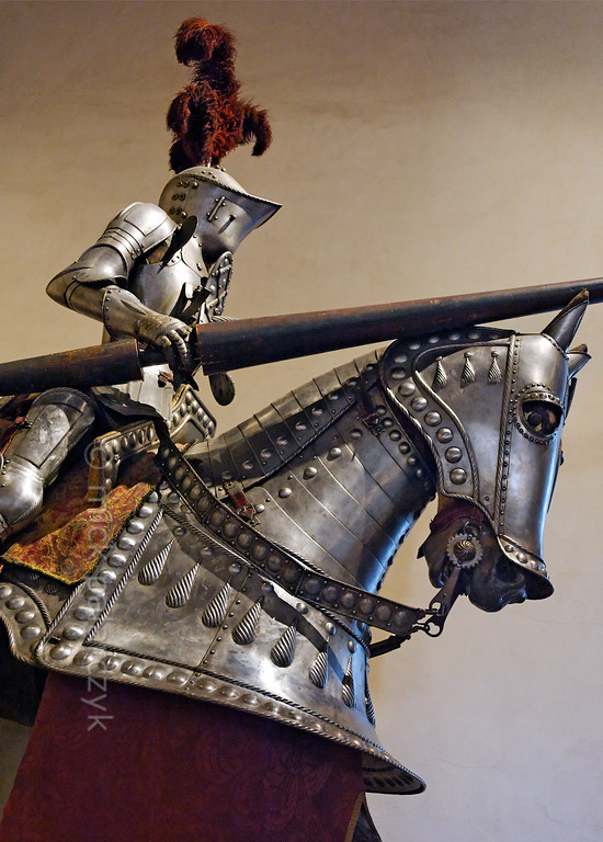 [SPAIN.CLEON 28576] 'Equestrian armour in Segovia's Alcazar.'  The Old Castle Room of Segovia's Alcazar boasts a 15th century German-style equestrian suit of armour. Photo Mick Palarczyk.