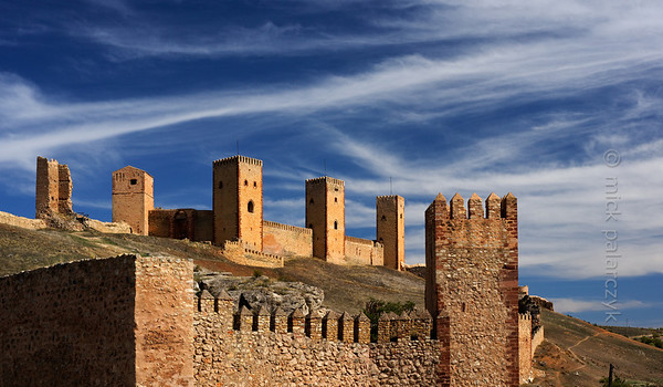 [SPAIN.CMANCHA 28539] 'Castle towers of Molina de Aragon.'  The castle of Molina de Aragon (Guadalajara province) was founded by the Moors in the 10th century. Molina was conquered by the king of Aragon in 1129 and was rebuilt in the 12th and 13th century. The actual castle, with the high towers we see in this picture, was built into a corner of the alcazaba precinct. Photo Mick Palarczyk.