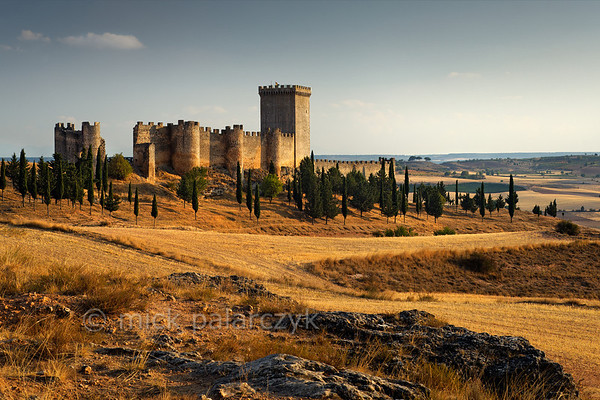 [SPAIN.CLEON 28626] 'Castle of Peñaranda de Duero.'  	The castle of Peñaranda (Burgos province), set on a hill just north of the Duero, was originally part of the 9th-11th century Moorish defense line against the Christians along this river. In the 10th century it was taken by the latter and was used as a centre of Christian repopulation on the northern margin of the Duero. The river (and the castles along it) formed the southern border of the Kingdom of Castile till the second half of the 11th century. Peñaranda Castle was rebuilt in the 15th century. Photo Mick Palarczyk.
