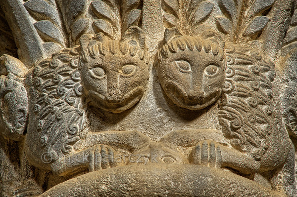 [SPAIN.ARAGON 28705] 'Romanesque capital in Loarre Castle.'  A group of lions adorns a capital in the apse of the Romanesque church of San Pedro in Loarre Castle. The castle of Loarre crowns a great outcrop of rock that juts out of the Pyrenean foothills north of the city of Huesca. The central core of the castle was built in 1020-1035 by king Sancho III of Navarra (and ruler of the emergent kingdom of Aragon) to protect his territory from the Moors in Huesca. In 1071 king Sancho Ramirez of Aragon extended the castle with a fortified (Augustinian) monastery and a church. Photo Mick Palarczyk.