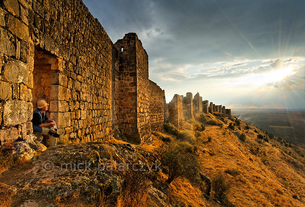 [SPAIN.CLEON 28663] 'North wall of Gormaz Castle.'  	The castle of Gormaz (Soria province) was built in the 9th century and reinforced in 965 by Caliph Al-Hakam II of Córdoba to defend Moorish territory. Built on a steep narrow narrow ridge, just north of the Duero, it was the most important fortress along this river that formed the boundary between Moslem and Christian lands in the 9th - 11th century. It was conquered and reconquered several times by both sides. In 1087 King Alfonso VI of Castile gave it to El Cid. The fortress, which is one of the biggest in Europe, has the layout of a typical Moorish alcazaba: an extensive walled precinct with a perimeter of 1 km that could house a large garrison. Photo Mick Palarczyk.
