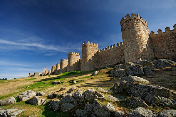 [SPAIN.CLEON 28610] 'Town wall of Ávila.'  Northern part of the medieval town walls of Ávila. The walls were constructed around 1090, when the Castilian king Alfonso VI reconquered Muslim territory south of the Duero river. They replaced an earlier Roman fortification. The city was declared a World Heritage Site by Unesco in 1985. Photo Mick Palarczyk.