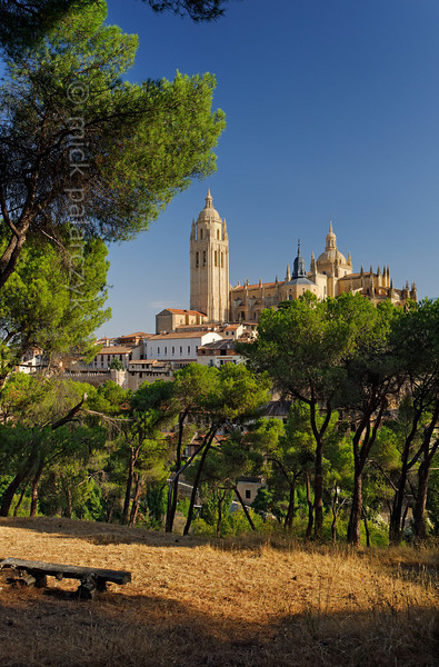 [SPAIN.CLEON 28585] 'Segovia's cathedral seen from the Clamores valley.'  From under the pines in the valley of the Clamores river there is a superb view of Segovia's cathedral. Construction of the cathedral started as late as 1525, making it the last major Gothic building in Spain. Photo Mick Palarczyk.