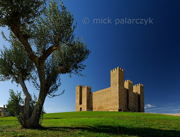 [SPAIN.ARAGON 28698] 'Castle of Sádaba.'  	The castle of Sádaba (Zaragoza province) was built in the early 13th century by the kingdom of Navarre to defend its frontier with Aragon. This type of compact castle was introduced in the 13th century - probably under the influence of Moorish fortress-building techniques. It could be defended by a smaller garrison than the older castle type which had a pronounced keep and encircling wall. Photo Mick Palarczyk.