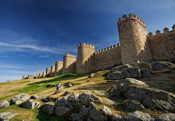[SPAIN.CLEON 28611] 'Town wall of Ávila.'  Northern part of the medieval town walls of Ávila. The walls were constructed around 1090, when the Castilian king Alfonso VI reconquered Muslim territory south of the Duero river. They replaced an earlier Roman fortification. The city was declared a World Heritage Site by Unesco in 1985. Photo Mick Palarczyk.