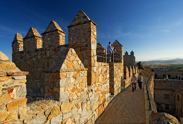 [SPAIN.CLEON 28613] 'On top of Ávila's town wall.'  	A walk along Ávila's medieval town walls provides fine views of the city and surrounding landscape. The walls were constructed around 1090, when the Castilian king Alfonso VI reconquered Muslim territory south of the Duero river. They replaced an earlier Roman fortification. The city was declared a World Heritage Site by Unesco in 1985. Photo Mick Palarczyk.
