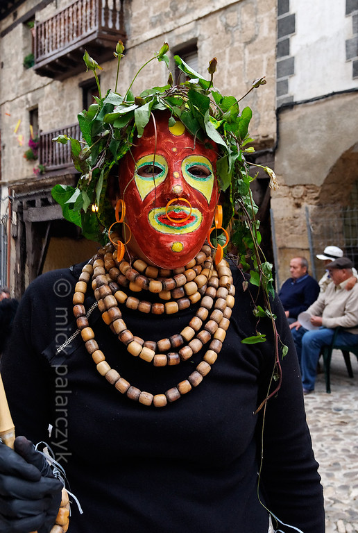 [SPAIN.CLEON 28620] 'Fiestas del Cristo in Frías.'  In the medieval centre of Frías (Burgos province) a festival goer of the Fiestas del Cristo (held in September) poses in her carnaval-like garb. Photo Mick Palarczyk.