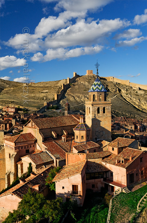 [SPAIN.ARAGON 28689] 'Albarracín and its town wall.'  Albarracín is a beautifully preserved medieval town in the canyon of the Guadalaviar river in the southwest of Teruel province. Its town wall (visible in the background) is partly of Moorish 10th -11th century origin and partly of 13th century Christian origin. In the 11th century the town was the capital of a taifa, an independent Muslim state ruled by the Banu Razin dynasty, whose family name would lend the town its name (Sahla Banu Razin). From 1170 till 1285 it was the capital of the small independent Christian kingdom of the Azagra family. Its medieval cathedral was remodeled in the 16th and 18th centuries. Photo Mick Palarczyk.