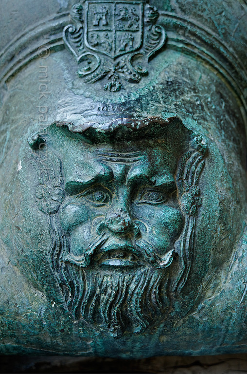 [SPAIN.CLEON 28579] 'Mortar in Segovia's Alcazar.'  A 17th century bronze mortar in the courtyard of Segovia's Alcazar is decorated with the head of a bearded man. Photo Mick Palarczyk.