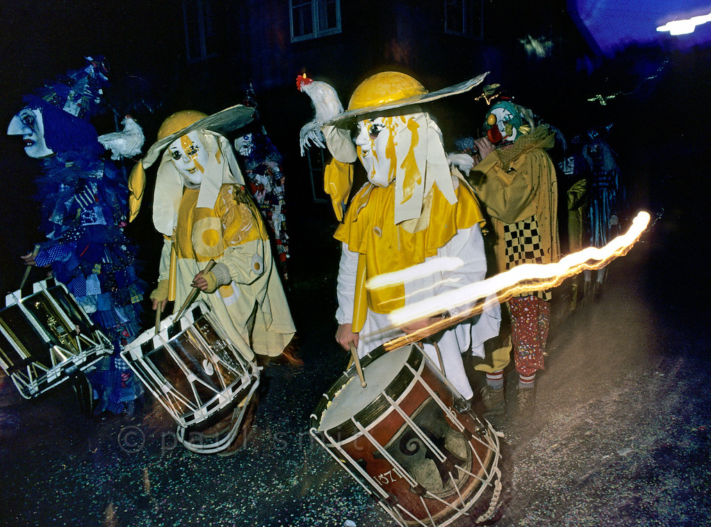 [SWITZER.JURA 6300] 'Morgestraich.'  <i>Morgestraich</i>, the start of the <i>Basler Fasnacht</i> (carnival of Basel) at four o'clock on a Monday morning. At that moment all street and shop lights are turned off. It is silent. And then this incredible noise breaks loose, consisting of seemingly random drumming and fierce piping. You need to study for years to do it right, however. Photo Paul Smit.